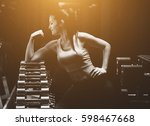 slim bodybuilder girl shows... | Shutterstock . vector #598467668