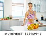 sporty woman standing near... | Shutterstock . vector #598469948