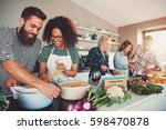 five friends cheerfully cooking ... | Shutterstock . vector #598470878