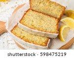 Homemade lemon cake with poppy seeds and sugar glaze. Selective focus - stock photo