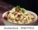 risotto with mushrooms  fresh...   Shutterstock . vector #598475924