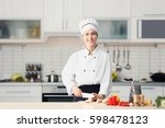 female chef cutting mushrooms... | Shutterstock . vector #598478123
