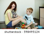 a child with her mother is...   Shutterstock . vector #598495124