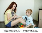 a child with her mother is... | Shutterstock . vector #598495136