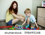 a child with her mother is...   Shutterstock . vector #598495148