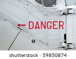 danger sign on the side of a riveted aircraft fuselage - stock photo