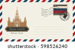 an envelope with a postage... | Shutterstock .eps vector #598526240