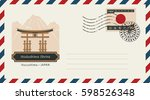 an envelope with a postage... | Shutterstock .eps vector #598526348