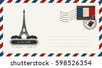 an envelope with a postage... | Shutterstock .eps vector #598526354