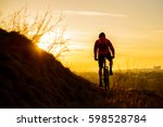 silhouette of enduro cyclist... | Shutterstock . vector #598528784