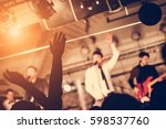 people at a party in nightclub   Shutterstock . vector #598537760