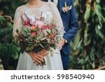the groom in a suit and the... | Shutterstock . vector #598540940