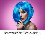 beautiful girl in blue wig | Shutterstock . vector #598560443