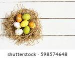 Easter Eggs On White Wooden...