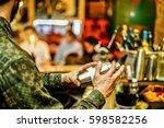 trendy bearded bartender... | Shutterstock . vector #598582256