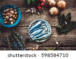 fresh sardines. fish with... | Shutterstock . vector #598584710