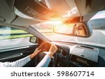 woman drive a car reflects in... | Shutterstock . vector #598607714