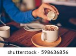 man hand pouring a syrup mug... | Shutterstock . vector #598636856