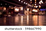 empty wood table top on blur... | Shutterstock . vector #598667990