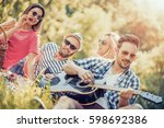 happy young friends having... | Shutterstock . vector #598692386