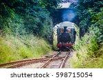 vintage steam train arriving to ... | Shutterstock . vector #598715054