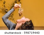 woman wants to swallow fish... | Shutterstock . vector #598719440
