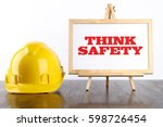 safety helmet and white board... | Shutterstock . vector #598726454
