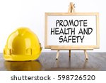 safety helmet and white board... | Shutterstock . vector #598726520
