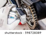 lubricating motorcycle chain... | Shutterstock . vector #598728389