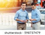 two businessman talking about... | Shutterstock . vector #598737479