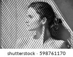 black and white portrait of a... | Shutterstock . vector #598761170