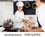 positive woman cook in white... | Shutterstock . vector #598763990