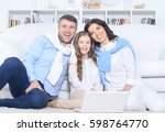 family with daughter using... | Shutterstock . vector #598764770