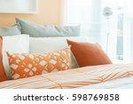 orange  white and gray pillows... | Shutterstock . vector #598769858