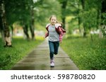 girl 6 7 runs in the autumn park | Shutterstock . vector #598780820