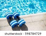pair of plastic dumbbells for... | Shutterstock . vector #598784729