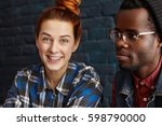 cute redhead girl with hair bun ... | Shutterstock . vector #598790000