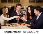 friends at a restaurant... | Shutterstock . vector #598823279