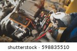 mechanic works with car... | Shutterstock . vector #598835510