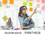 creative businesswoman reading... | Shutterstock . vector #598874828