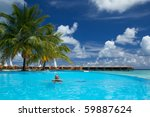 Young Man Enjoying Infinity Pool In The Maldives! - stock photo