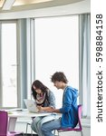 business colleagues using... | Shutterstock . vector #598884158