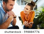 happy couple at cafe sitting... | Shutterstock . vector #598884776
