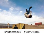 Young Boy Jumping Somersault O...