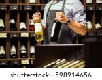 young sommelier holding bottle... | Shutterstock . vector #598914656