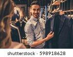 beautiful couple is choosing... | Shutterstock . vector #598918628
