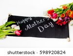 gift for woman with tulips | Shutterstock . vector #598920824