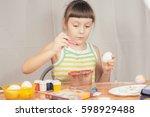 girl with easter eggs | Shutterstock . vector #598929488