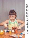 girl with easter eggs | Shutterstock . vector #598929500