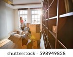 woman unpacking lamp from... | Shutterstock . vector #598949828